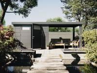 Wolff Finnhaus Metallhaus Eleganto 3024 Granitgrau inkl. 280 cm Seitendach rechts, Dachrinne und Fallrohr